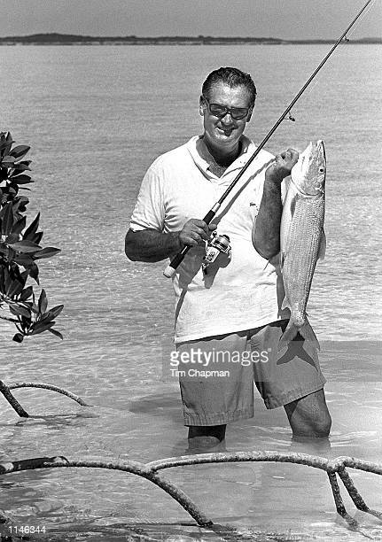 Ted Williams the baseball great and expert angler holds a 10 lb bonefish on a Bahamian Flat in 1980
