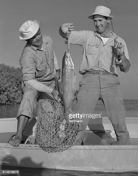 Ted Williamsstar slugger of the Boston Red Sox holds up the 10 pound bonefish he caught on an angling expedition on the Florida Keys Guide Jimmy...