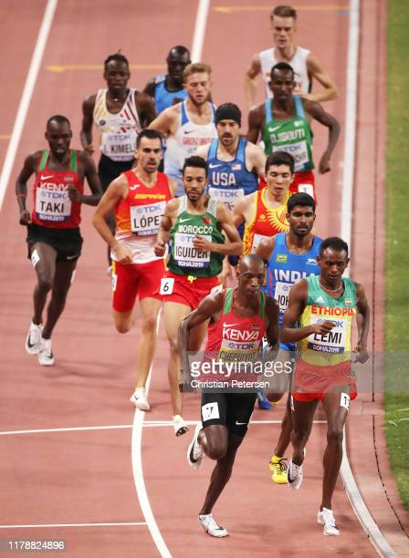 Teddese Lemi of Ethiopia and Timothy Cheruiyot of Kenya compete in the Men's 1500 Metres heats during day seven of 17th IAAF World Athletics...