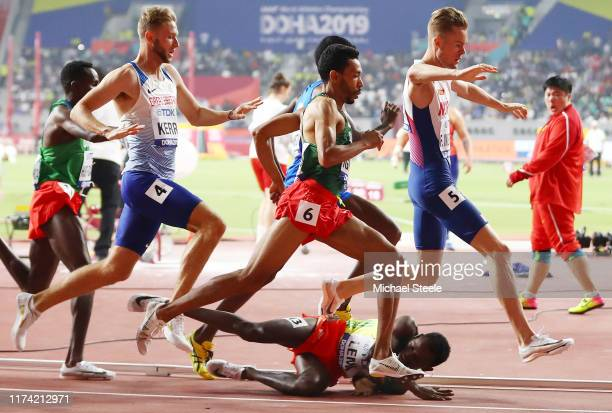 Teddese Lemi of Ethiopia falls after contact with Filip Ingebrigtsen of Norway and others compete in the Men's 1500 Metres heats during day seven of...