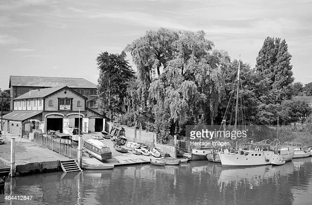 Teddington boat house and slipway Richmond 19451965 with river boats tied up along the banks of the River Thames