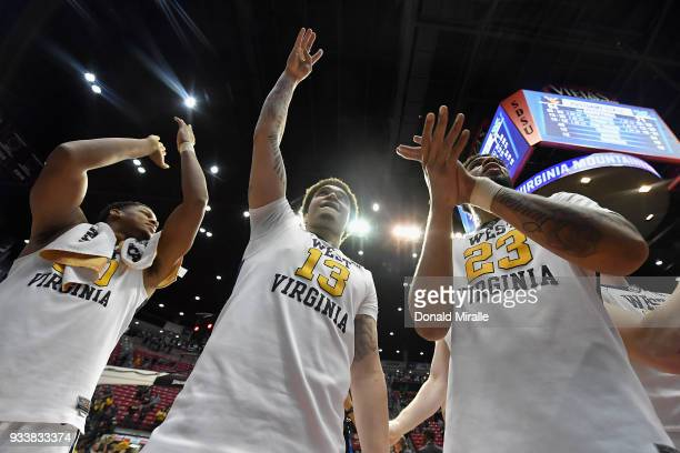 Teddy Allen and Esa Ahmad of the West Virginia Mountaineers celebrate their 9471 win over the Marshall Thundering Herd during the second round of the...