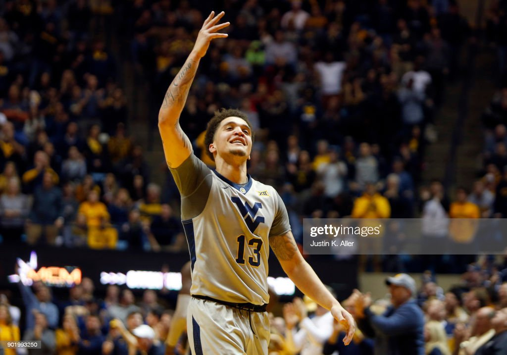 Teddy Allen #13 of the West Virginia Mountaineers celebrates against the Oklahoma Sooners at the WVU Coliseum on January 6, 2018 in Morgantown, West Virginia.