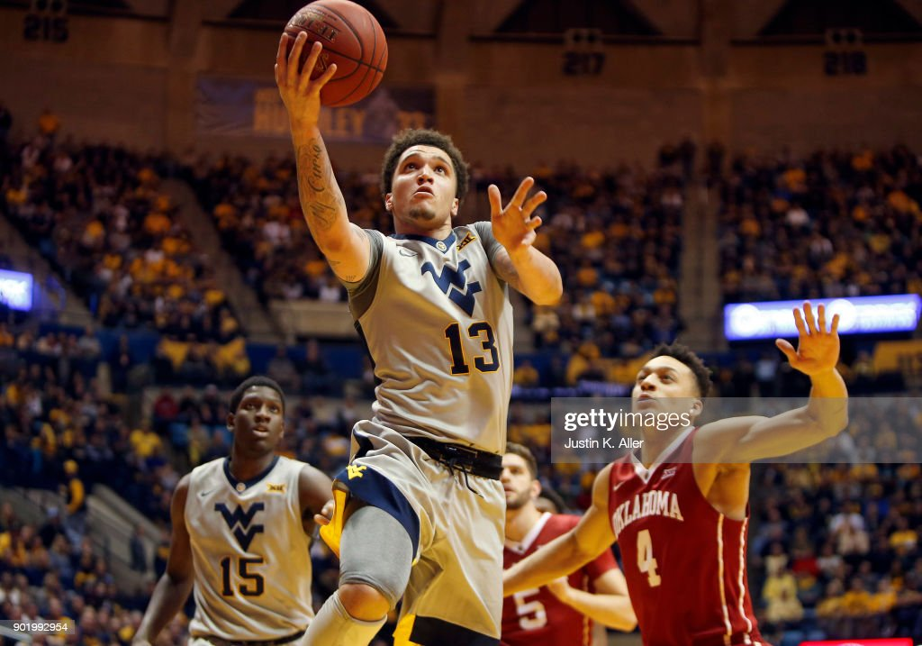 Teddy Allen #13 of the West Virginia Mountaineers lays one in against Jamuni McNeace #4 of the Oklahoma Sooners at the WVU Coliseum on January 6, 2018 in Morgantown, West Virginia.