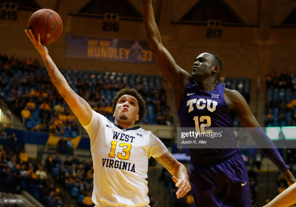 Teddy Allen #13 of the West Virginia Mountaineers lays one in against Kouat Noi #12 of the TCU Horned Frogs at the WVU Coliseum on February 12, 2018 in Morgantown, West Virginia.