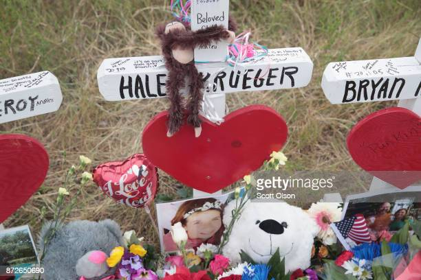 Teddy bear and a photograph lay at the foot of a cross honoring 16yearold Haley Krueger at a memorial where 26 crosses were placed to honor the 26...