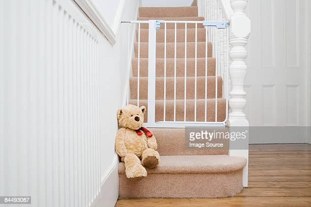 Teddy bear and stair gate