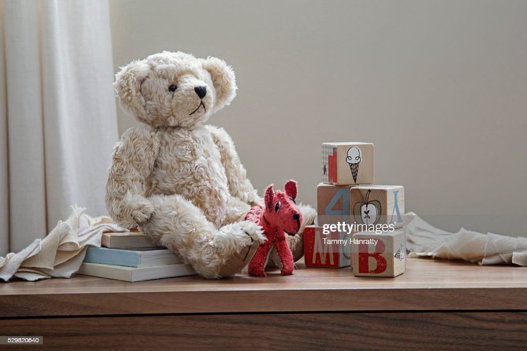 Teddy bear and toys on shelf : Stock Photo