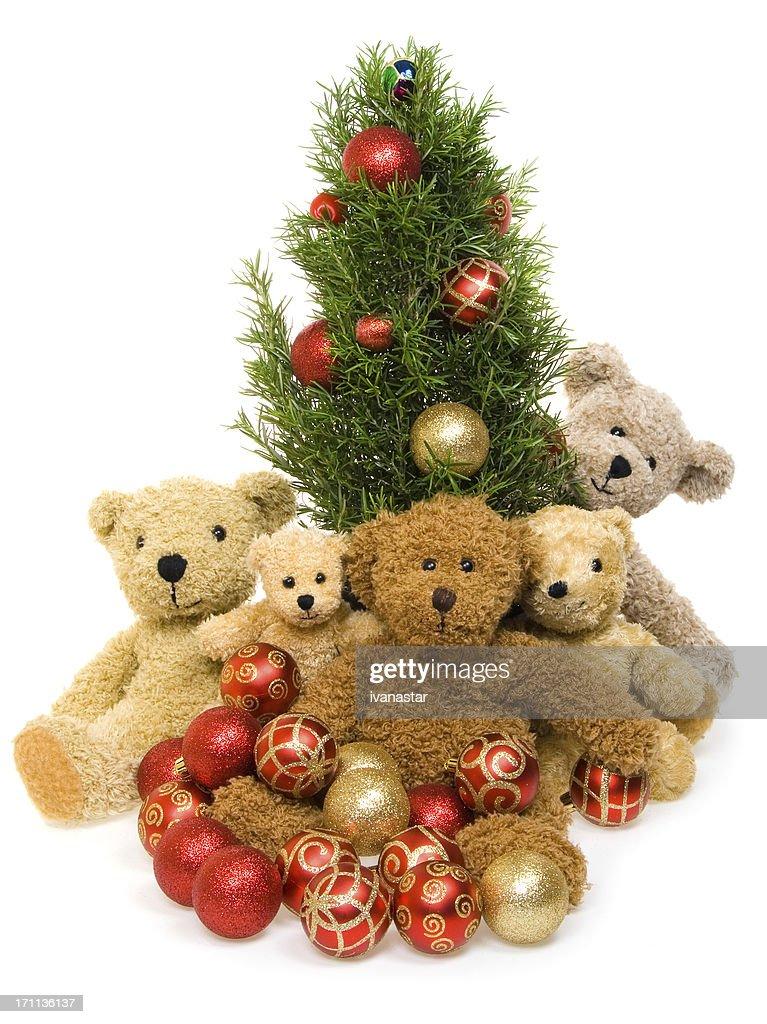 teddy bear family with christmas tree stock photo