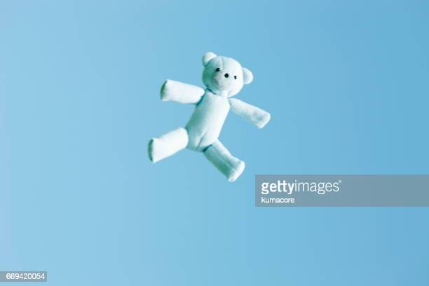 teddy bear floating in the clear sky - ぬいぐるみ ストックフォトと画像