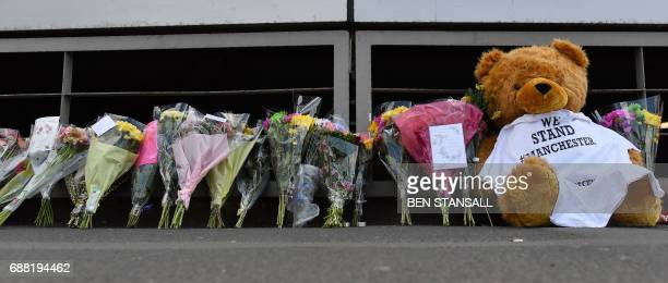 A teddy bear flowers and messages of support are pictured outside Victoria Station car park near to the Manchester Arena in Manchester northwest...