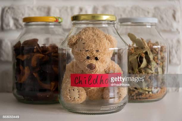 Teddy bear in jar