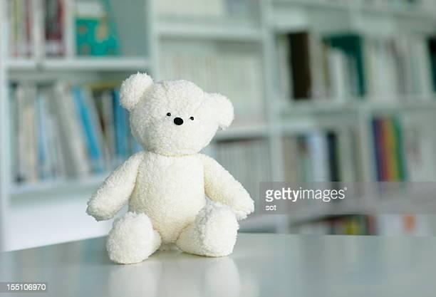 teddy bear in library - ぬいぐるみ ストックフォトと画像