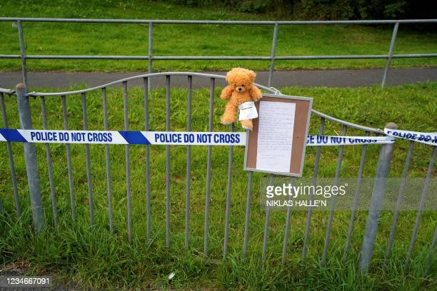 Teddy bear is placed at the police perimeter near the scene of a shooting incident in Plymouth, southwest England, on August 14, 2021. - Police said...