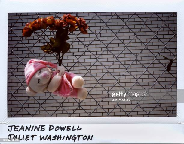 A teddy bear is placed in a chain link fence for Jeanine Dowell 32yearold and Juliet Washington 41yearold in the 5400 block of South Wabash in...