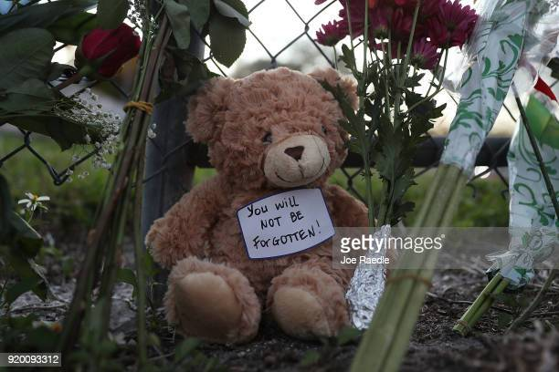 A teddy bear is seen in a makeshift memorial setup in front of Marjory Stoneman Douglas High School on February 18 2018 in Parkland Florida Police...