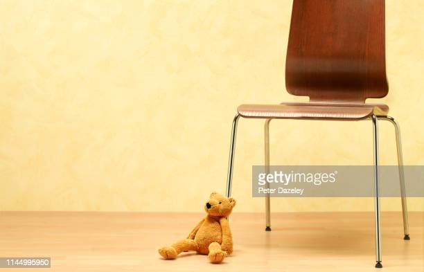 teddy bear left abandoned on floor - teddy bear stock pictures, royalty-free photos & images