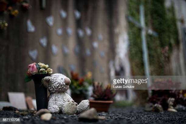 A teddy bear lies at the memorial of the 2010 Love Parade disaster on December 6 2017 in Duisburg Germany On December 8 six city officials and four...