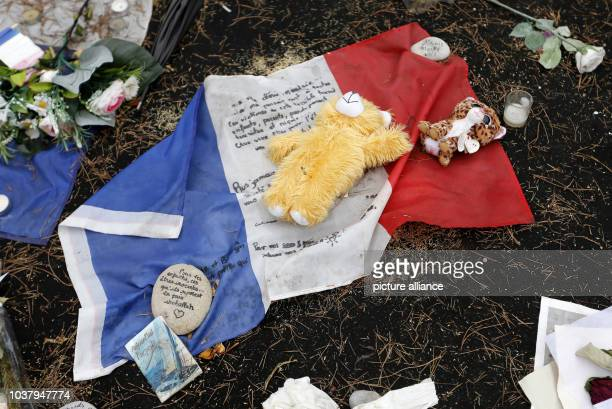 A teddy bear lying on a French flag can be seen on the 'Promenade des Anglais' in Nice France 14 September 2016 A 31yearold Tunisian man had driven...