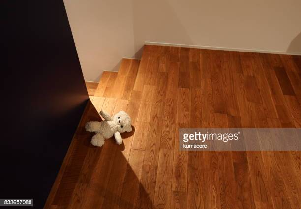 teddy bear lying on floor - lying in state stock pictures, royalty-free photos & images