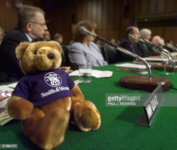 A teddy bear marketed by gunmaker Smith Wesson sits on the table as Tom Diaz from the Violence Police Center and other experts testify at the US...