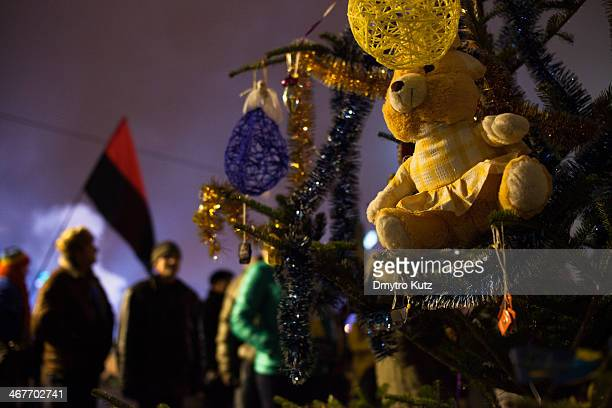 Teddy bear on a New Year tree during the New Year 2014 celebration at Euromaidan in Kiev in time of protests against Victor Yanukovych, with...