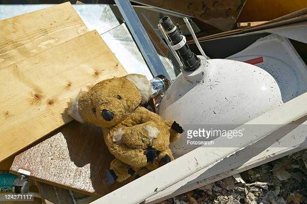Teddy Bear on couch sits atop rubble after Hurricane Ivan strikes