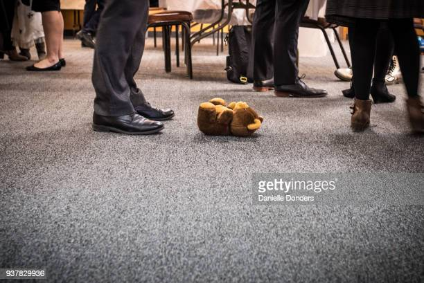 Teddy bear on the floor at a business event