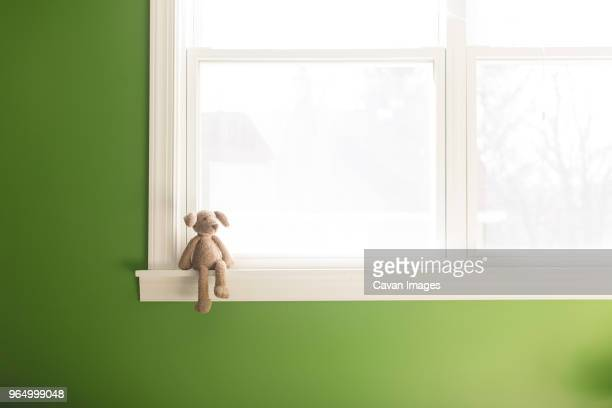 teddy bear on window sill at home - window sill stock pictures, royalty-free photos & images