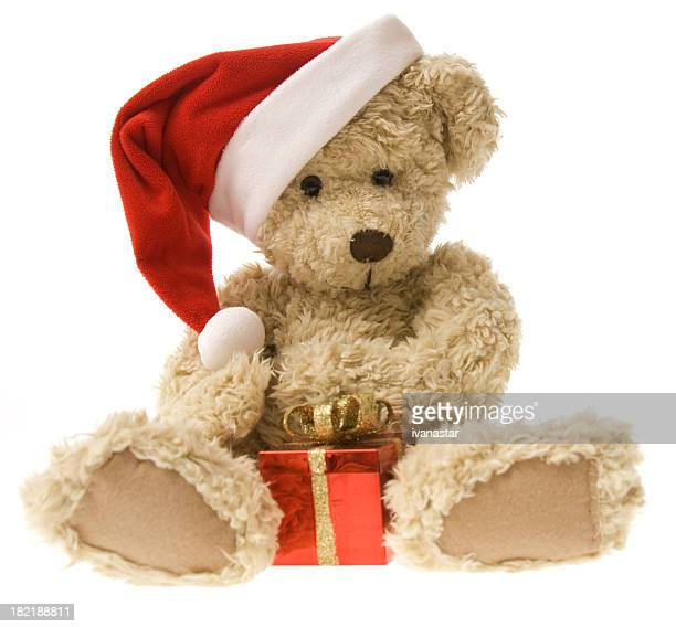 teddy bear opening christmas gift - dolly golden stock pictures, royalty-free photos & images