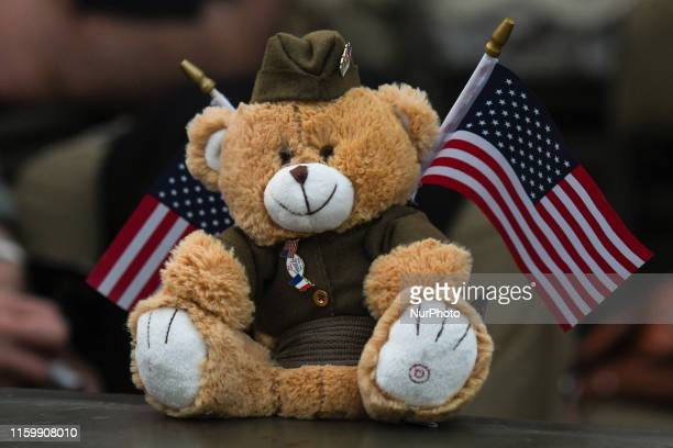 A Teddy bear toy with US flags seen attached to the US Army jeep during the Parade of Liberation in the streets of Granville a part of many events of...