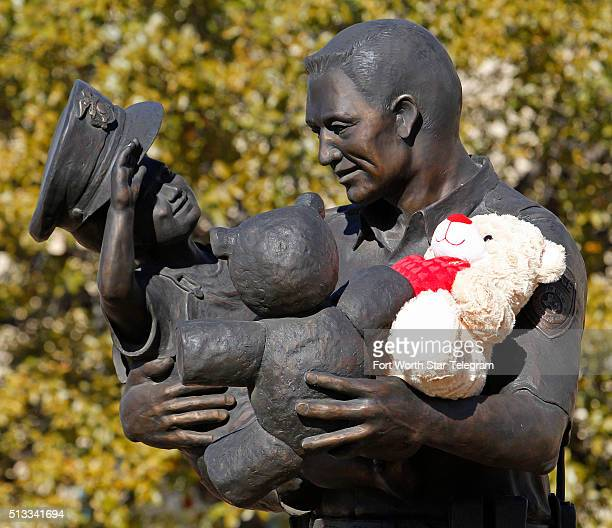 A teddy bear was placed on the statue in front of the Euless Police Headquarters by Scott Thomas on March 2 2016 in Euliss Texas Citizens and the...