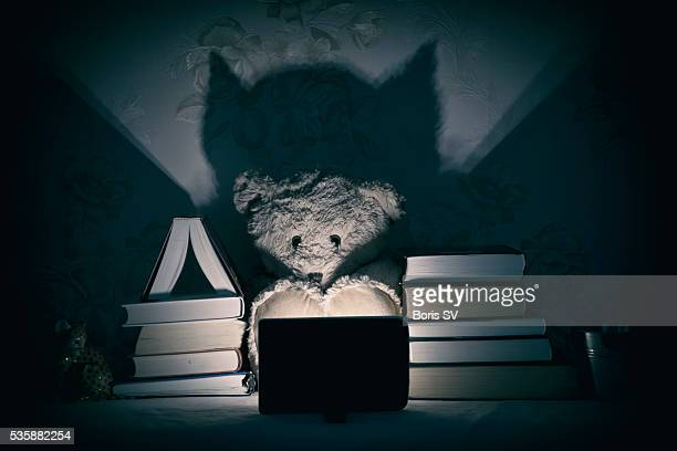 Teddy Bear watching horror movie instead of reading books