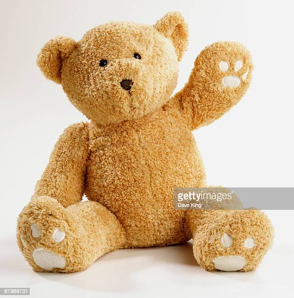 teddy bear waving - teddy bear stock pictures, royalty-free photos & images
