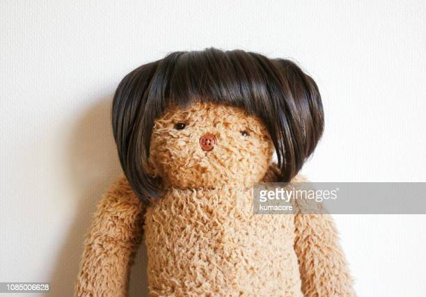 teddy bear wearing a wig - wig stock pictures, royalty-free photos & images