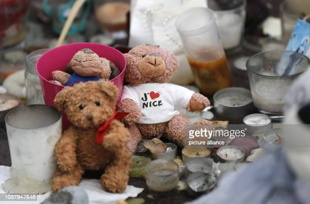 A teddy bear with a Tshirt reading 'I love Nice' lies on the 'Promenade des Anglais' in Nice France 14 September 2016 A 31yearold Tunisian man had...
