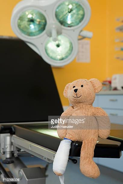 Teddy bear with dressing at couch