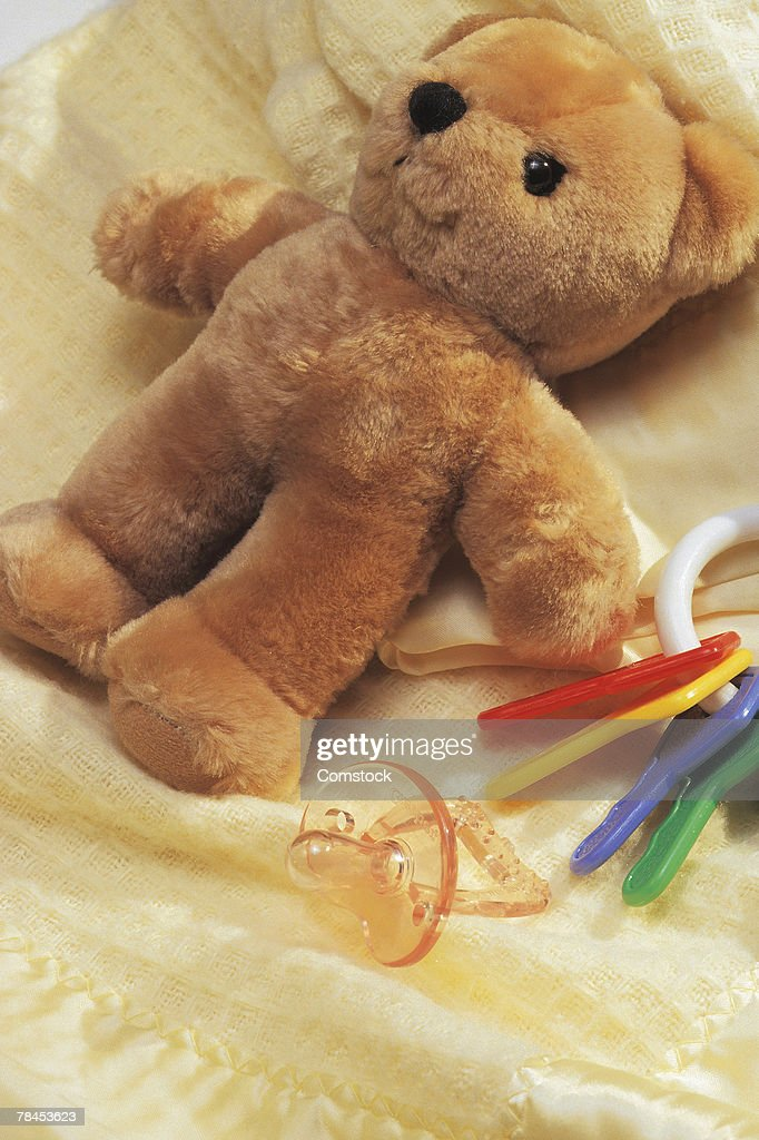 Teddy bear with key ring and pacifier : Stockfoto