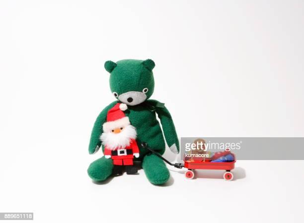 Teddy bear with Santa claus doll