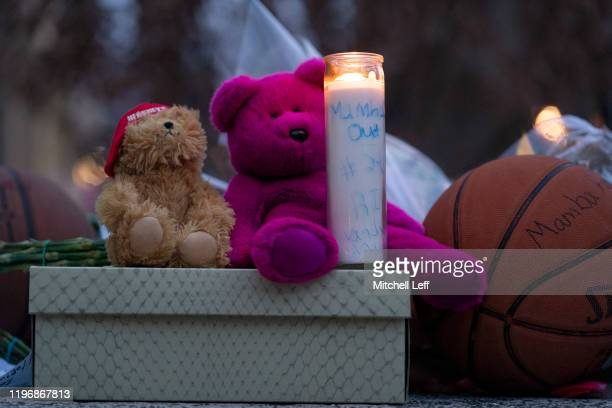 Teddy bears and a lit candle are left at a memorial for former Los Angeles Laker Kobe Bryant after he was killed in a helicopter crash at Lower...
