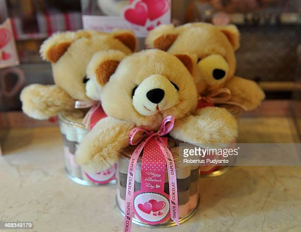Teddy Bears and chocolates with a Valentines design are displayed at Dapur Cokelat on February 10 2014 in Surabaya Indonesia Roses chocolates teddy...