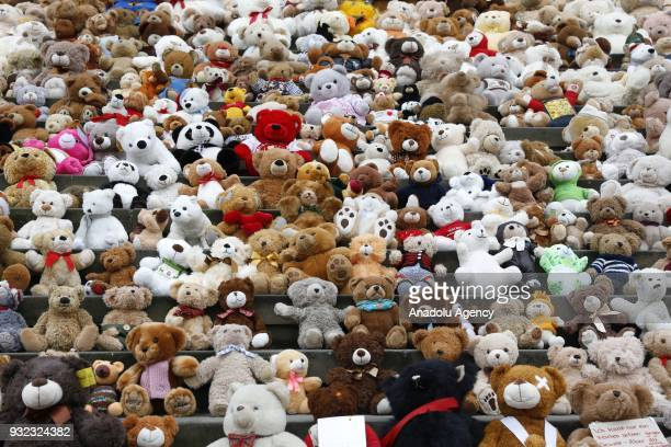 Teddy bears placed by children are seen on the stairs of the Concert Hall during 'Teddy Bear action Beyond Survival' organized by World Vision in...