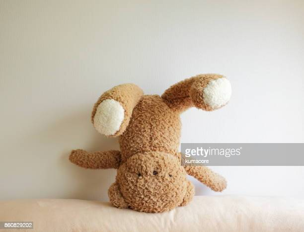 teddy bear's turned upside down - teddy bear stock photos and pictures