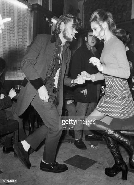 Teddy boy and a young woman jiving at the Black Raven club in London