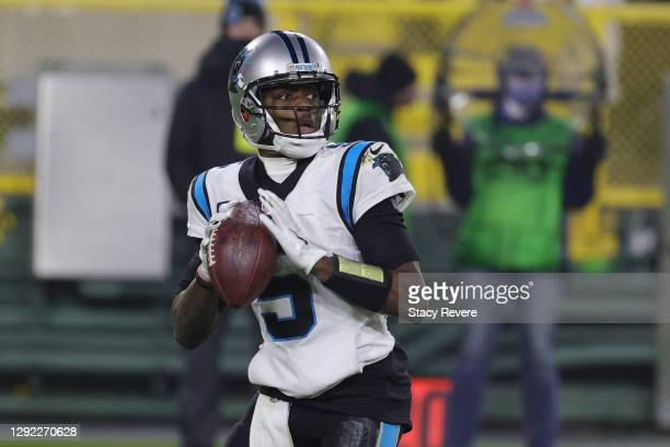 Teddy Bridgewater of the Carolina Panthers drops back to pass during a game against the Green Bay Packers at Lambeau Field on December 19, 2020 in...