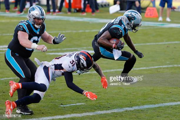 Teddy Bridgewater of the Carolina Panthers gets past Justin Simmons of the Denver Broncos for a seven-yard rushing touchdown during the fourth...