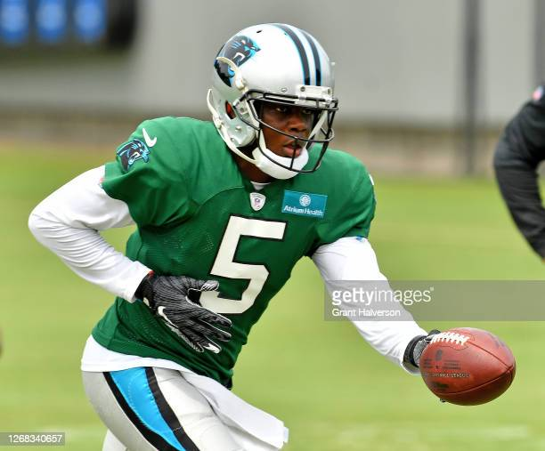 Teddy Bridgewater of the Carolina Panthers hands off during a training camp session at Bank of America Stadium on August 24, 2020 in Charlotte, North...