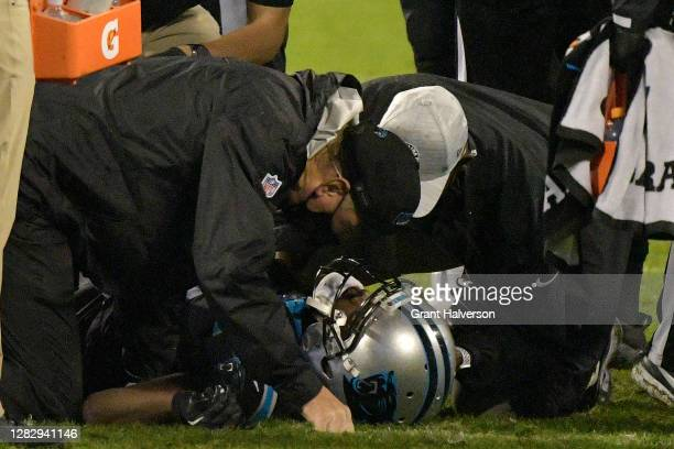 Teddy Bridgewater of the Carolina Panthers is looked at after being injured during the third quarter against the Atlanta Falcons at Bank of America...