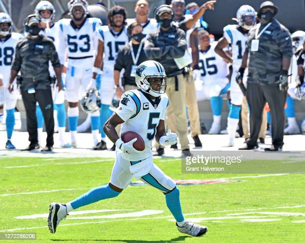 Teddy Bridgewater of the Carolina Panthers rolls out against the Las Vegas Raiders during the first quarter at Bank of America Stadium on September...