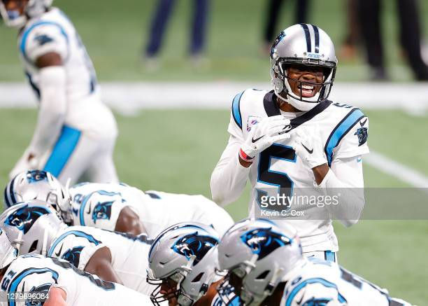 Teddy Bridgewater of the Carolina Panthers runs the offense against the Atlanta Falcons during the first half at Mercedes-Benz Stadium on October 11,...